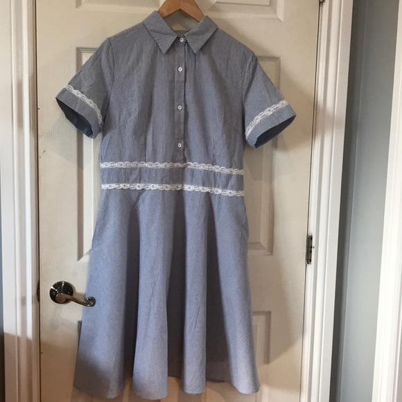 Blue and white striped dress with lace detailing